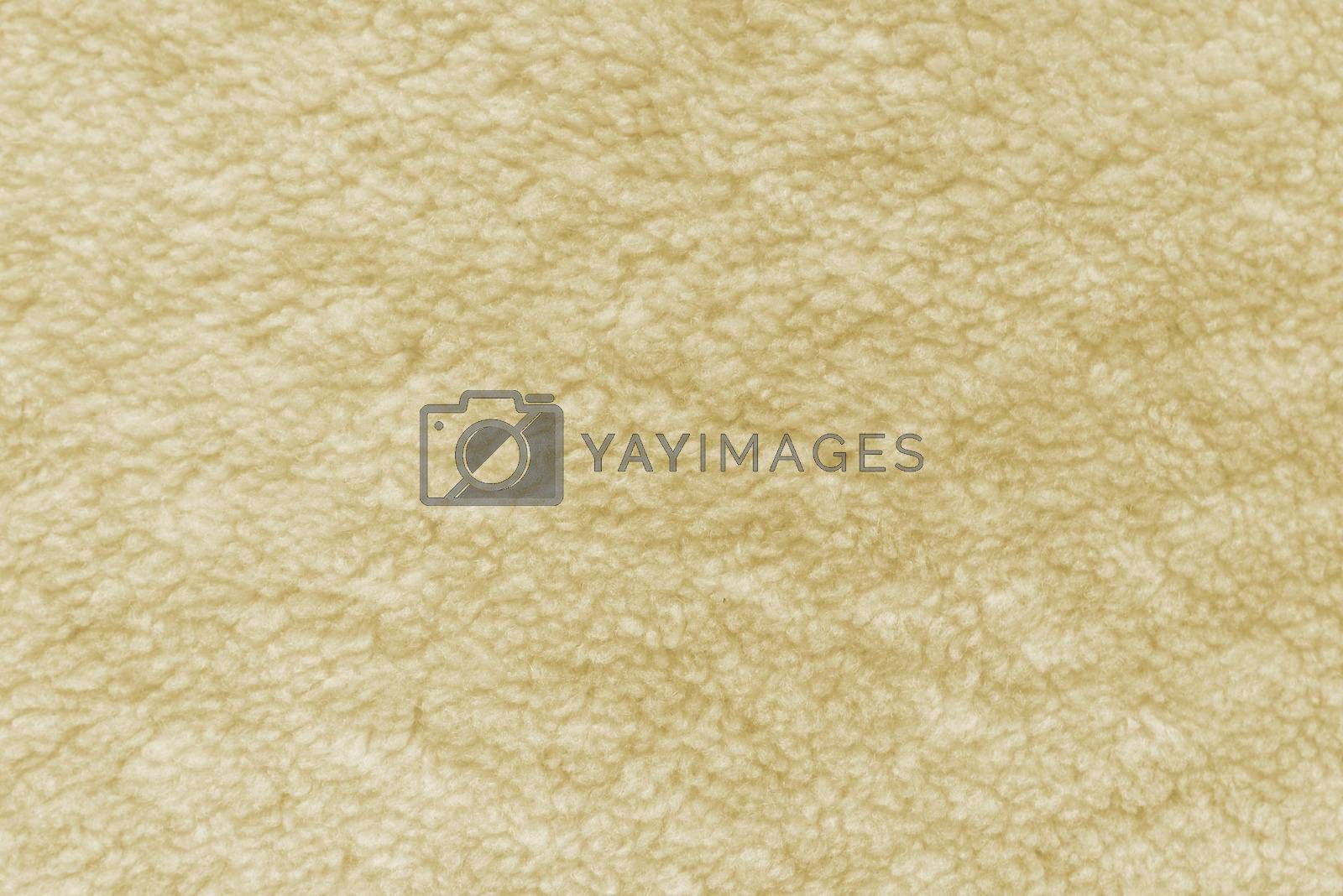 Close up texture of beige blanket as background