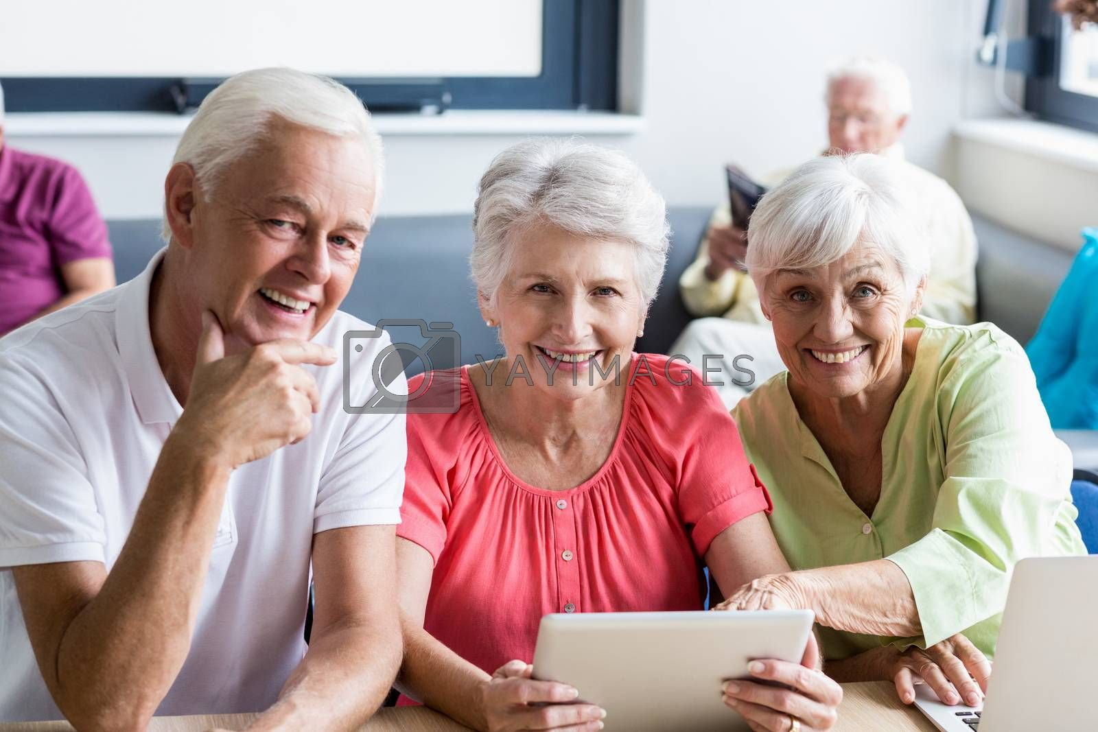 Seniors using technology in a retirement home