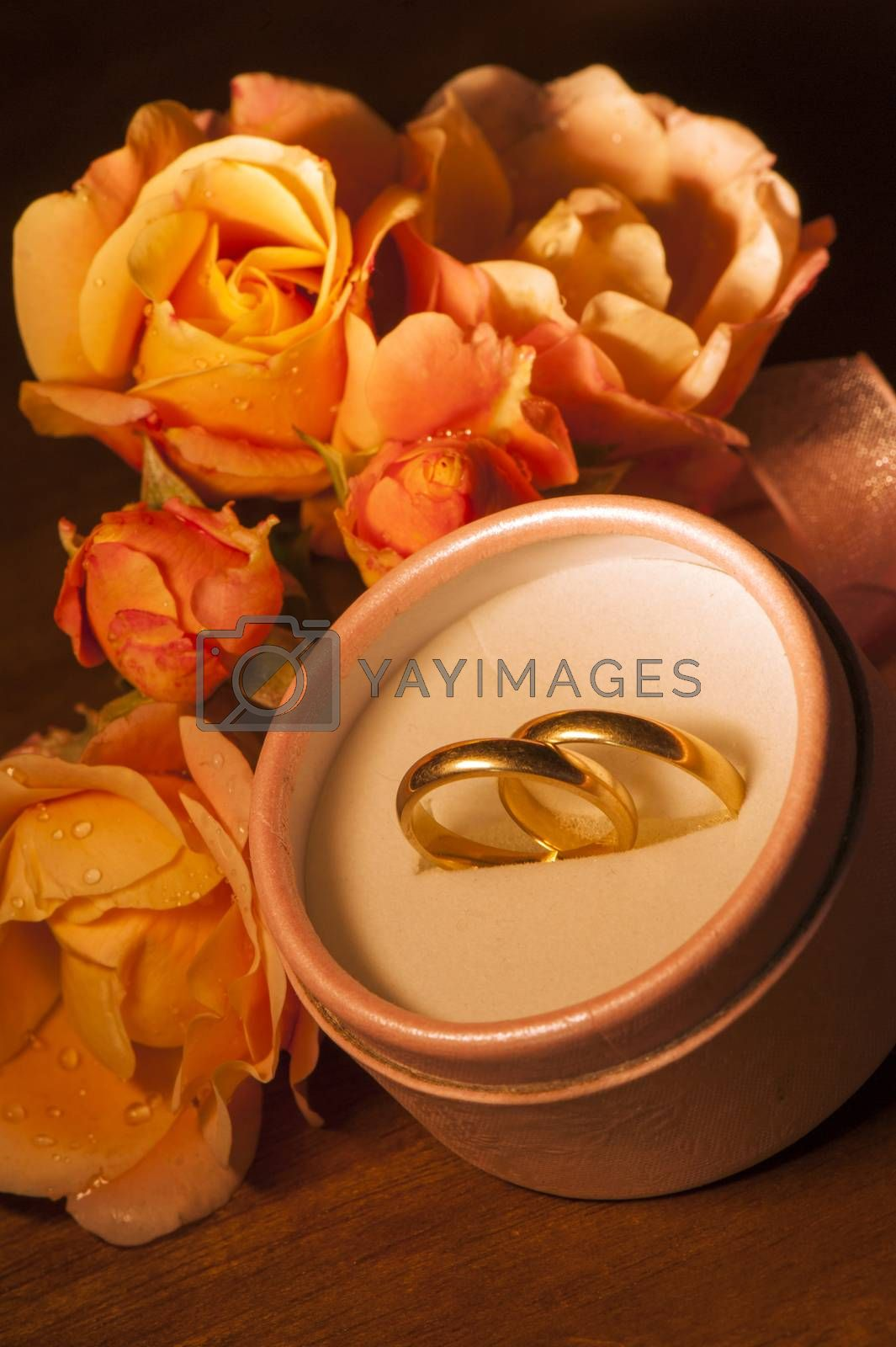 wedding rings on  on a small wooden table