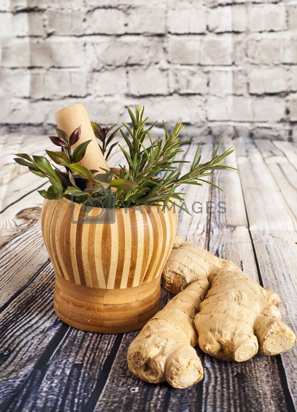 Ginger and herbs on a wooden board
