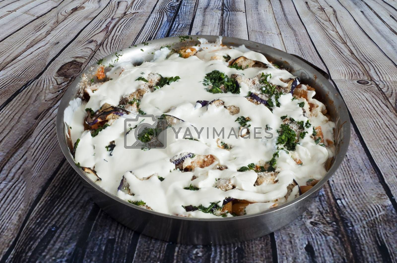 baked pasta with eggplant, bread and parmesan cheese