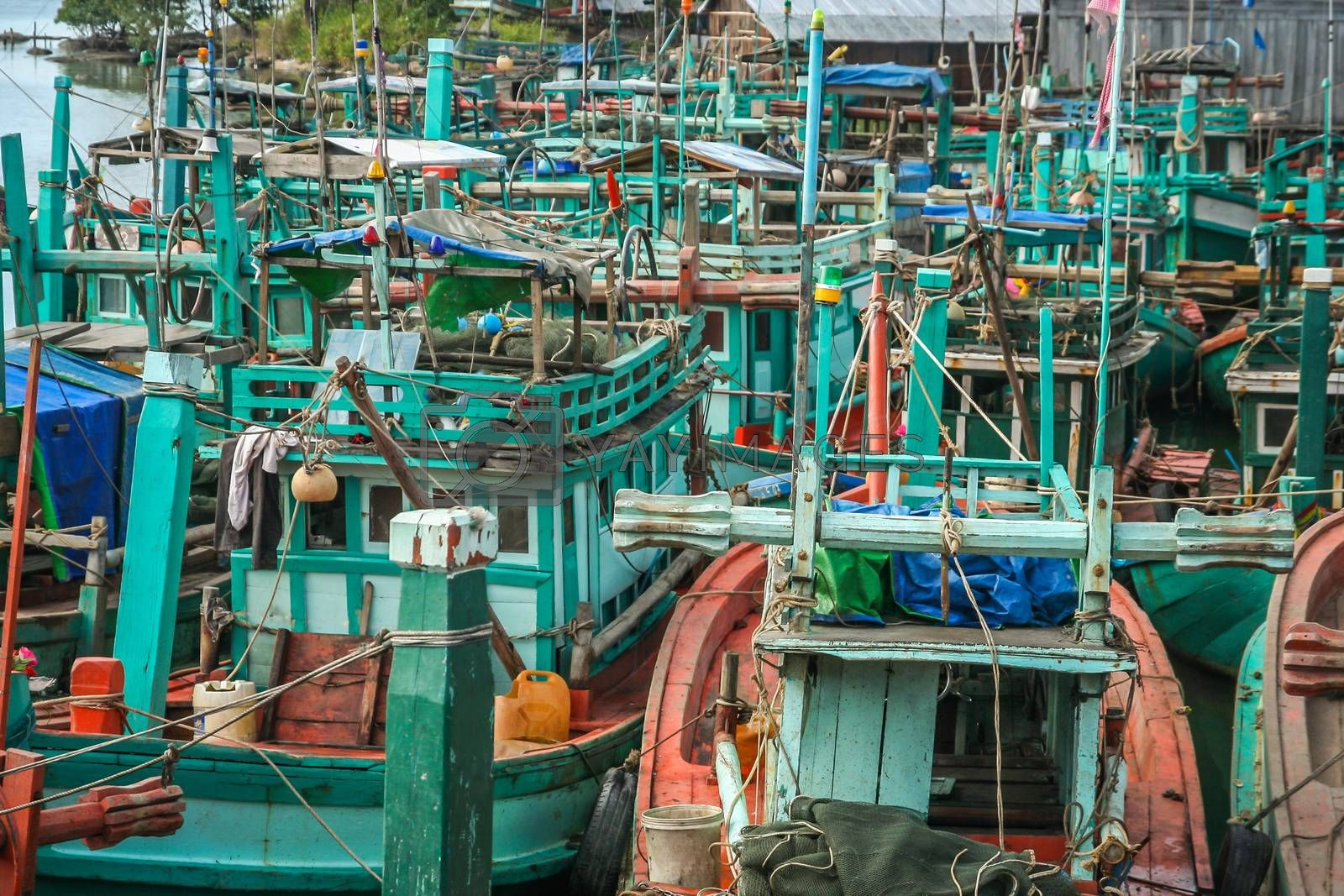 Old fishing boats in a small Cambodian seaside village