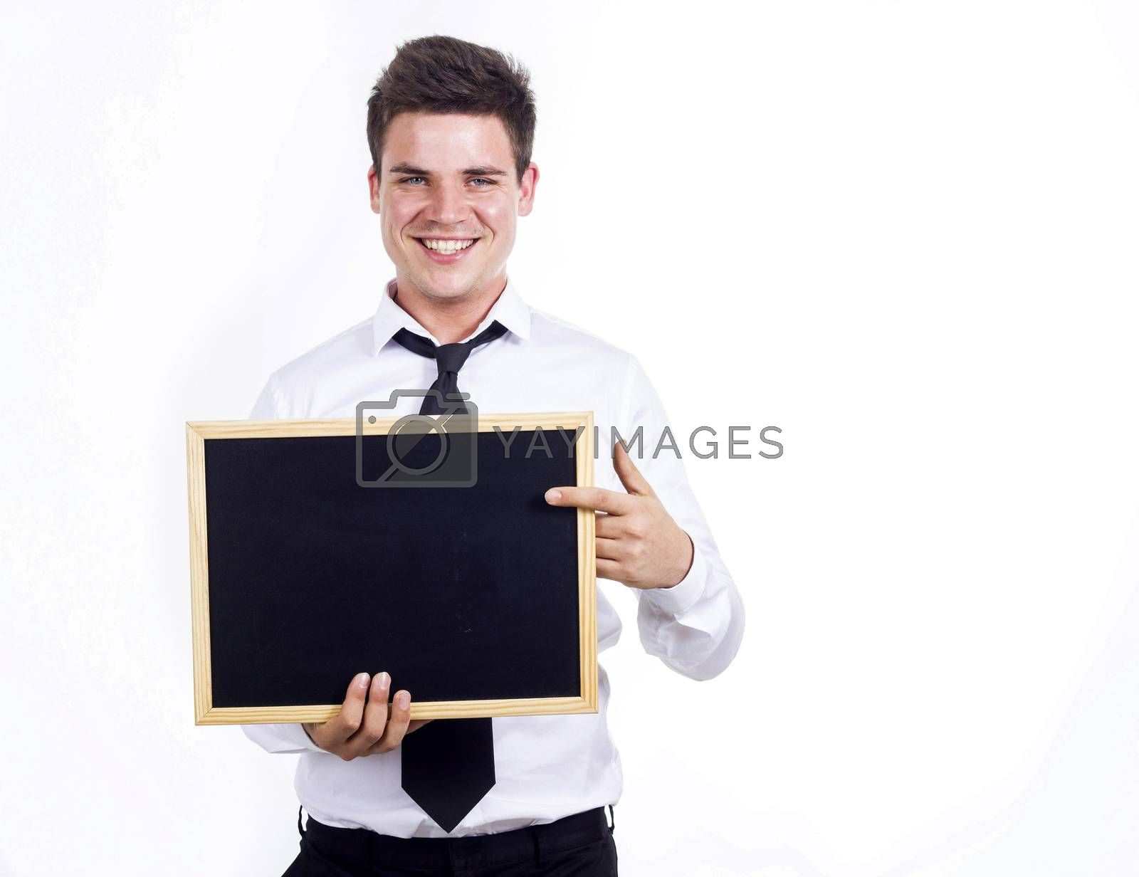 Young businessman holding blank wooden framed chalkboard isolated on white background