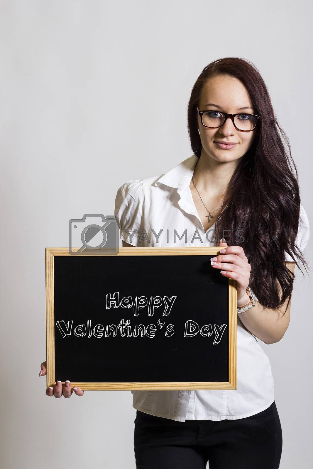 Happy Valentine's Day - Young businesswoman holding chalkboard - vertical image