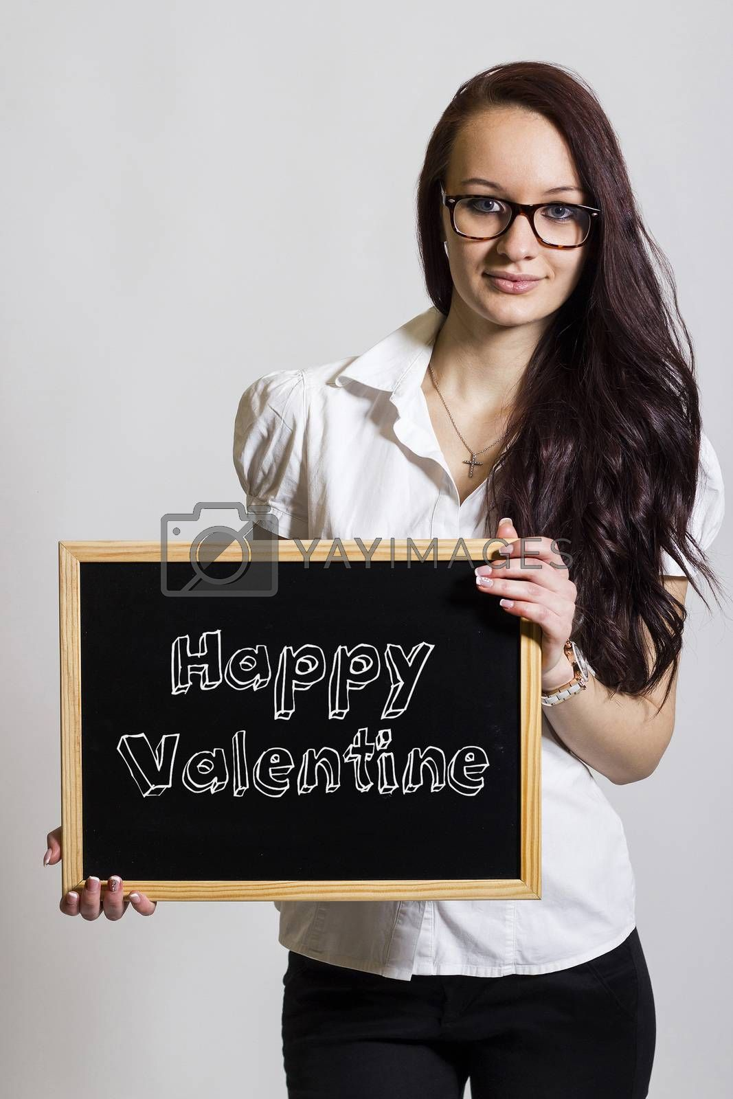 Happy Valentine - Young businesswoman holding chalkboard - vertical image