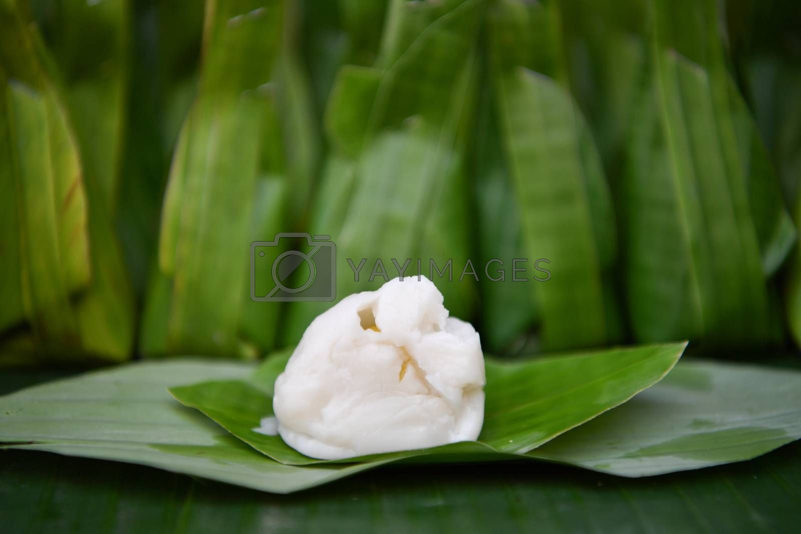 Steamed flour with coconut filling, flour in put grated coconut and wrapped in banana leaves steamed, Thai traditional dessert.