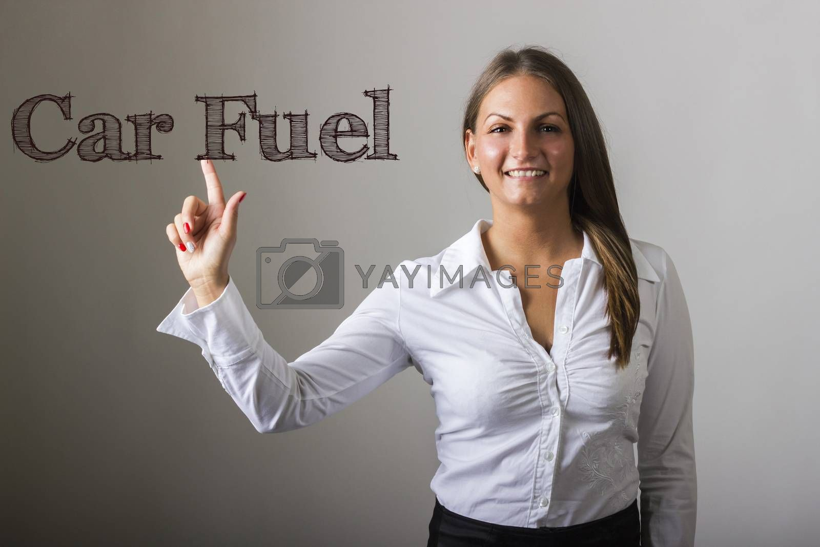Car Fuel - Beautiful girl touching text on transparent surface - horizontal image