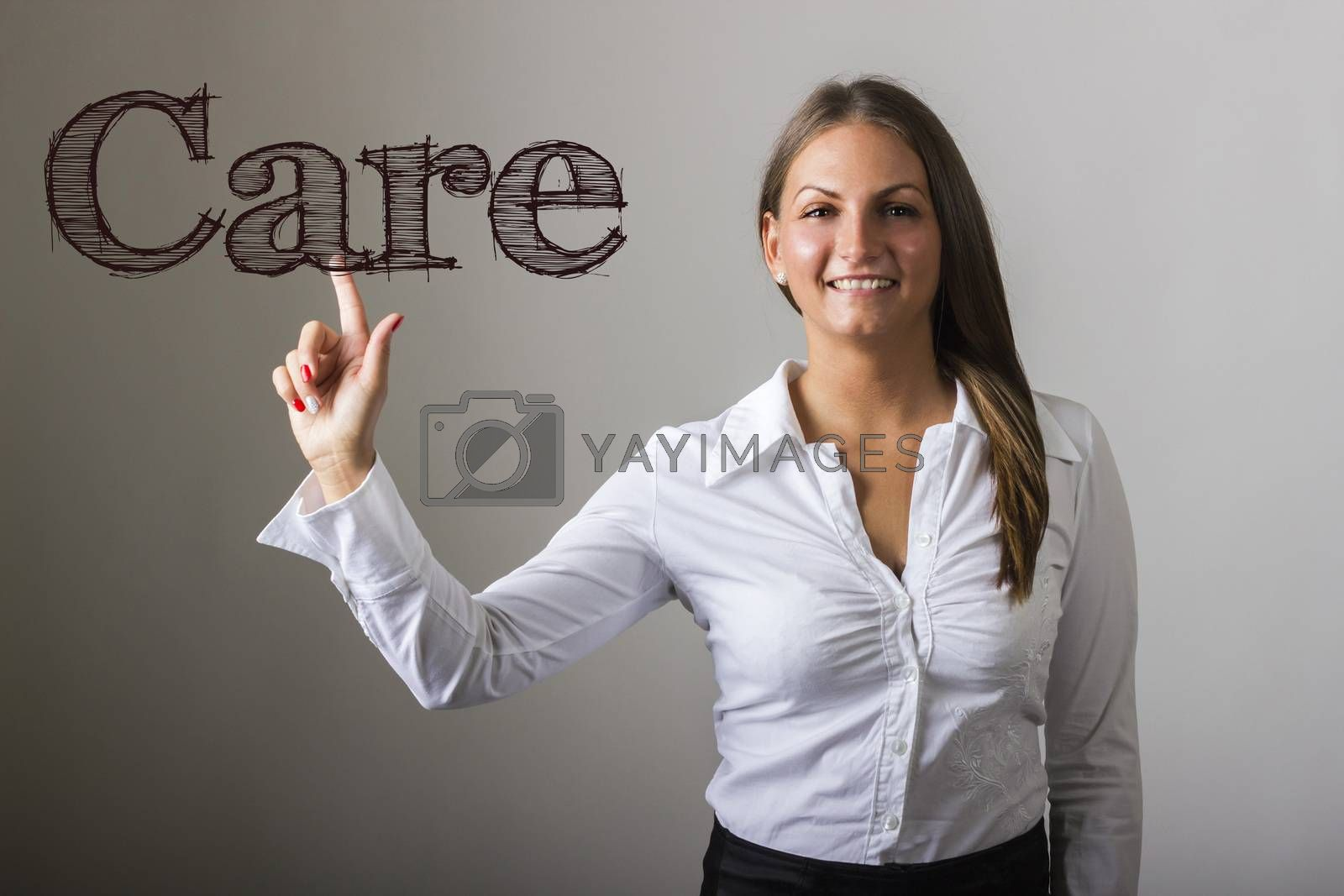 Care - Beautiful girl touching text on transparent surface - horizontal image