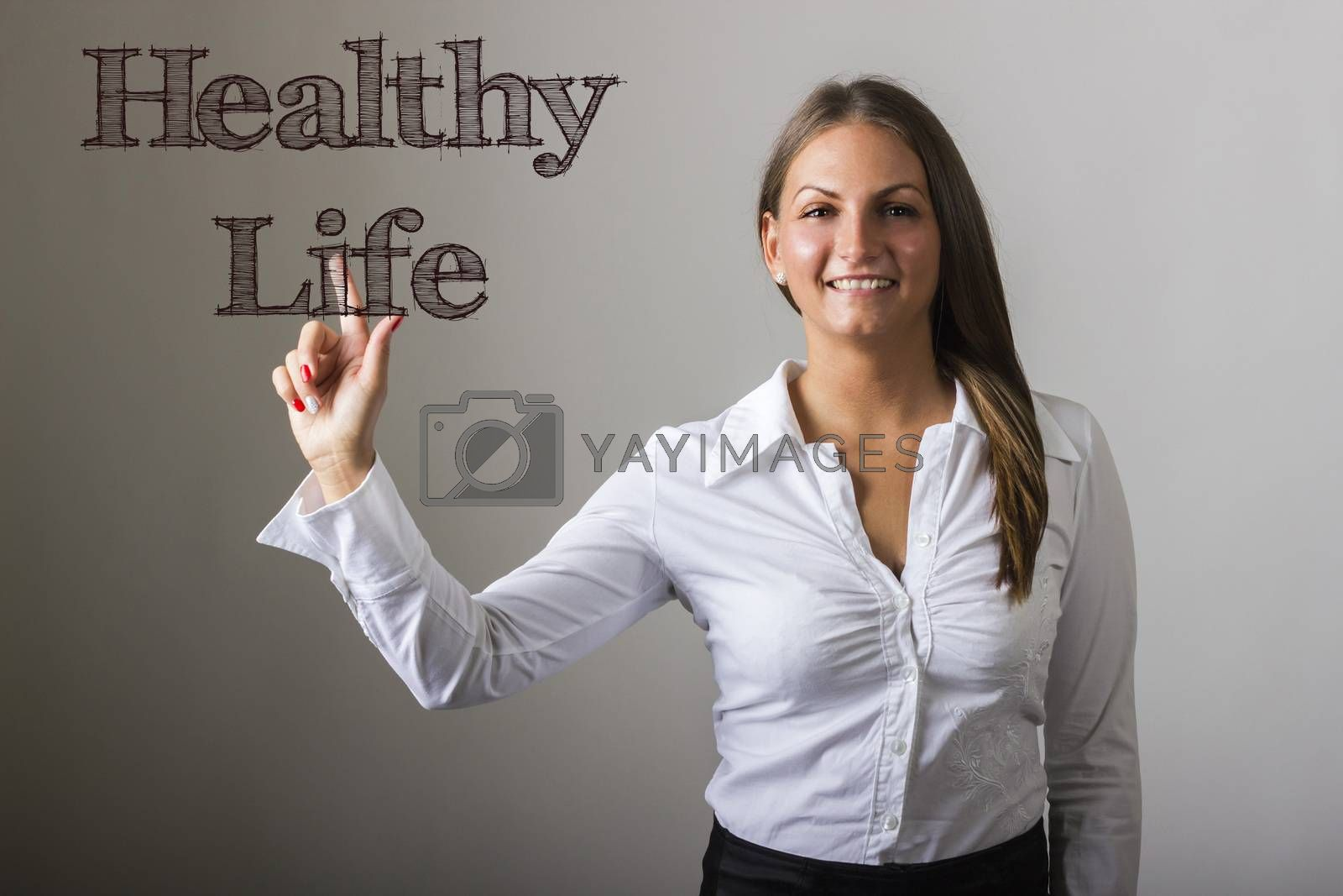 Healthy Life - Beautiful girl touching text on transparent surface - horizontal image