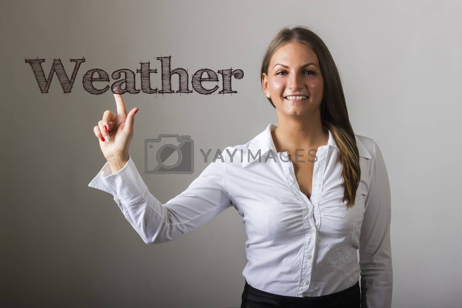 Weather - Beautiful girl touching text on transparent surface - horizontal image