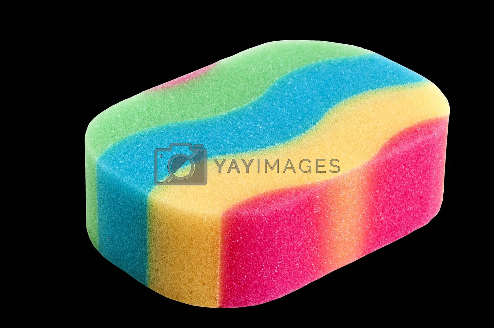 a  colored sponge  on a  black background