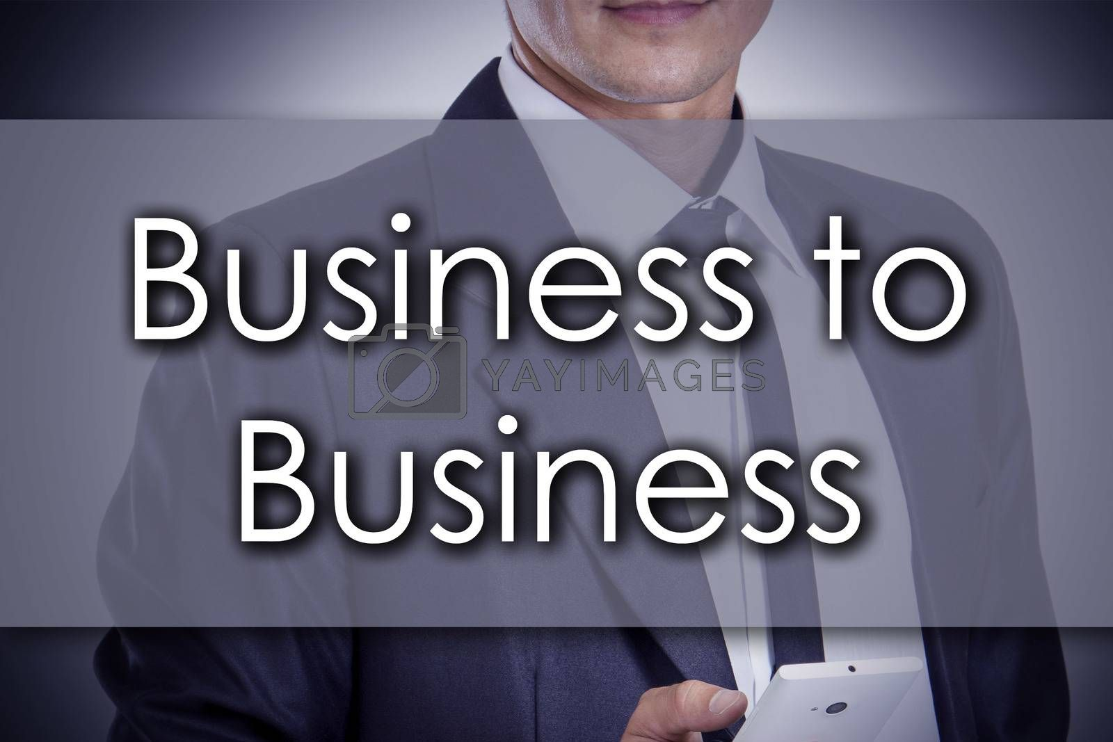 Business to Business - Young businessman with text - business co by zsirosistvan