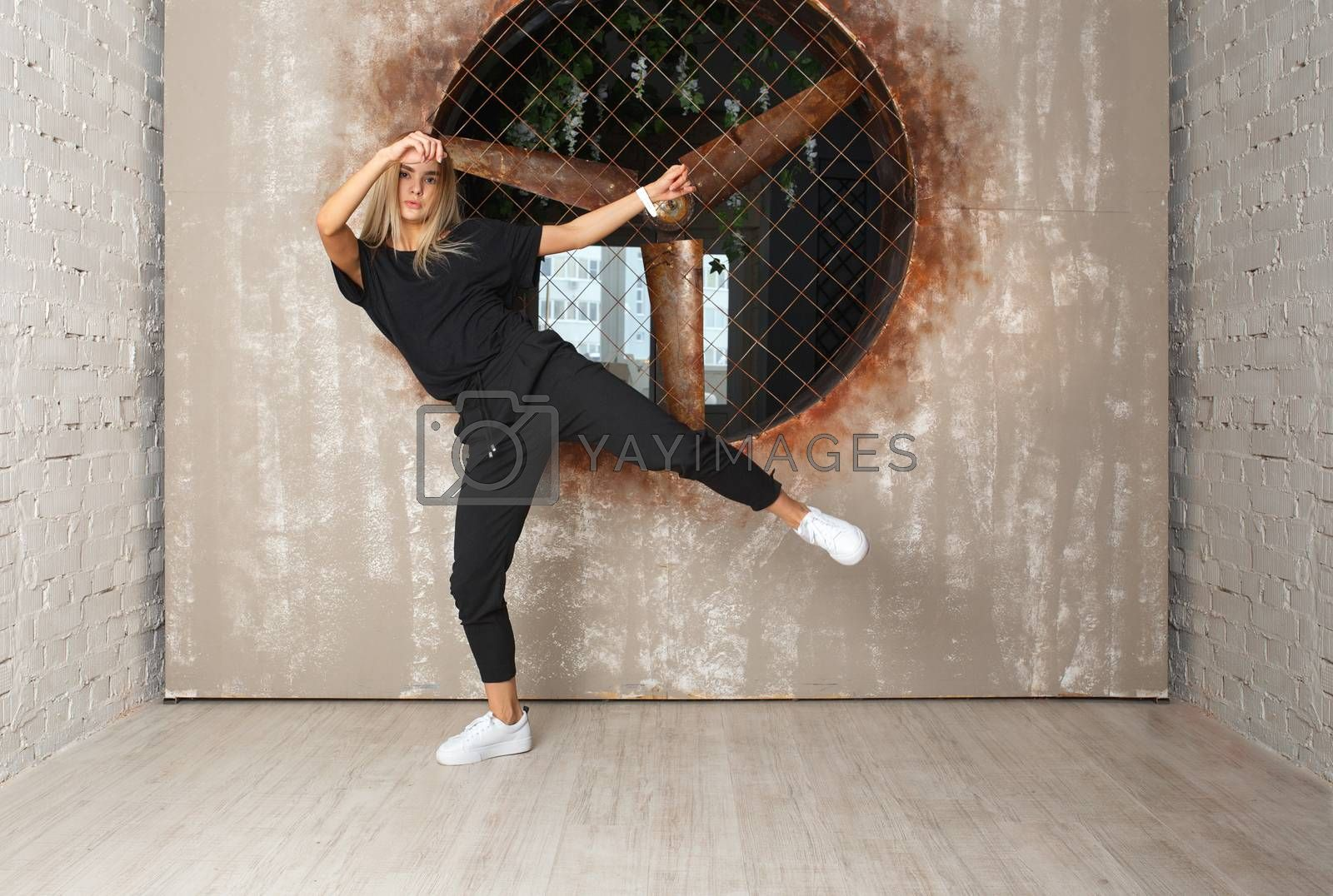 Street dance girl dancer on textured background