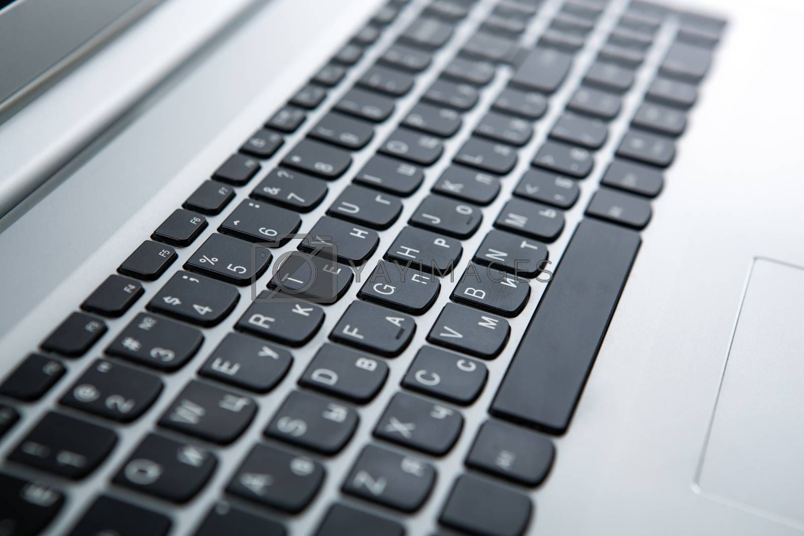 Royalty free image of modern gray laptop on a table on close up by mizar_21984