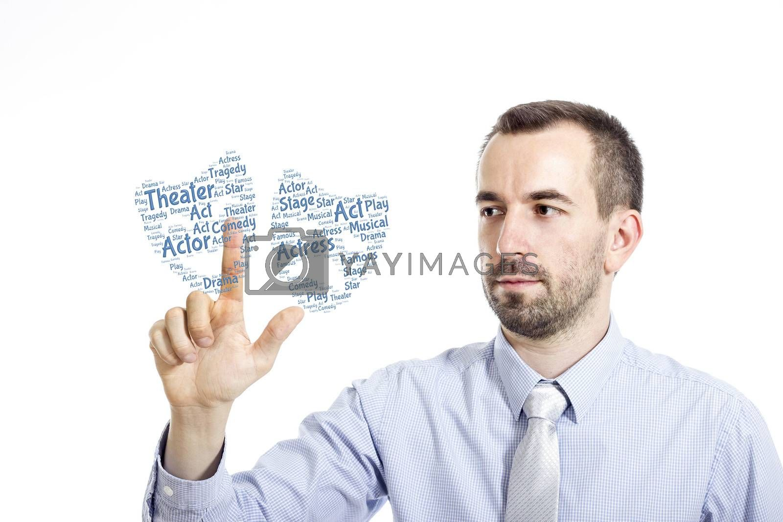 """Young businessman in blue shirt with small beard touching """"Theater"""" word cloud"""
