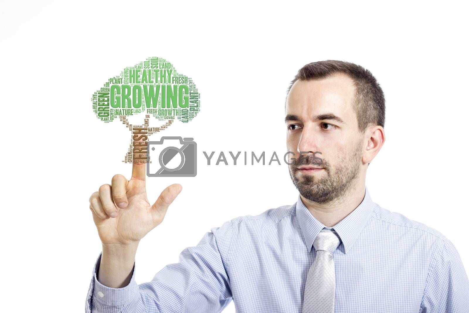 """Young businessman in blue shirt with small beard touching """"Growing"""" word cloud"""