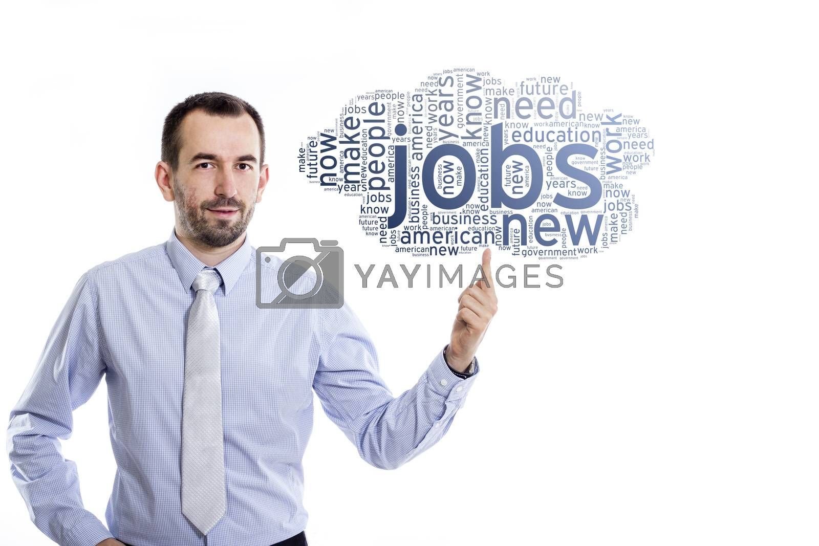 Young businessman with small beard pointing up to a blue word cloud