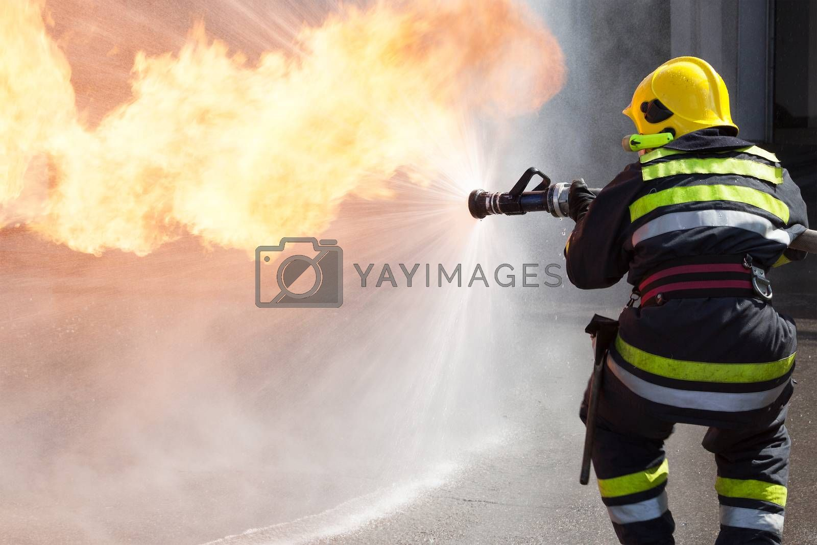 Fireman fighting fire during training