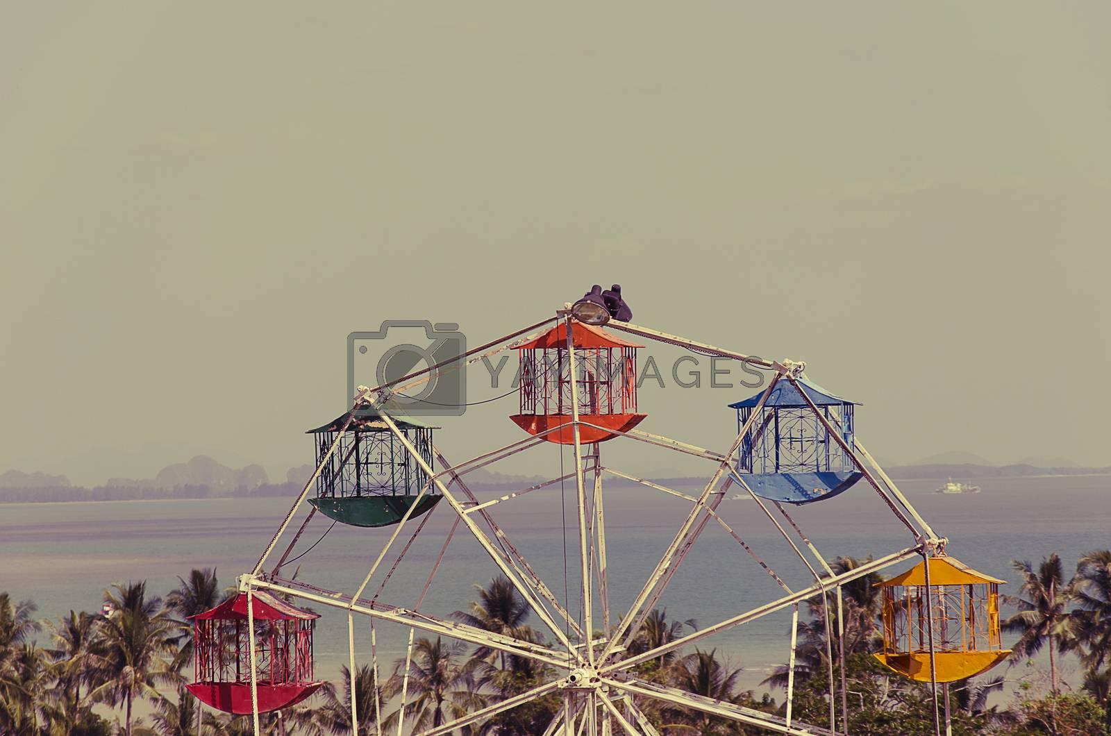 Ferris Wheel Over Blue Sky - vintage filter effect