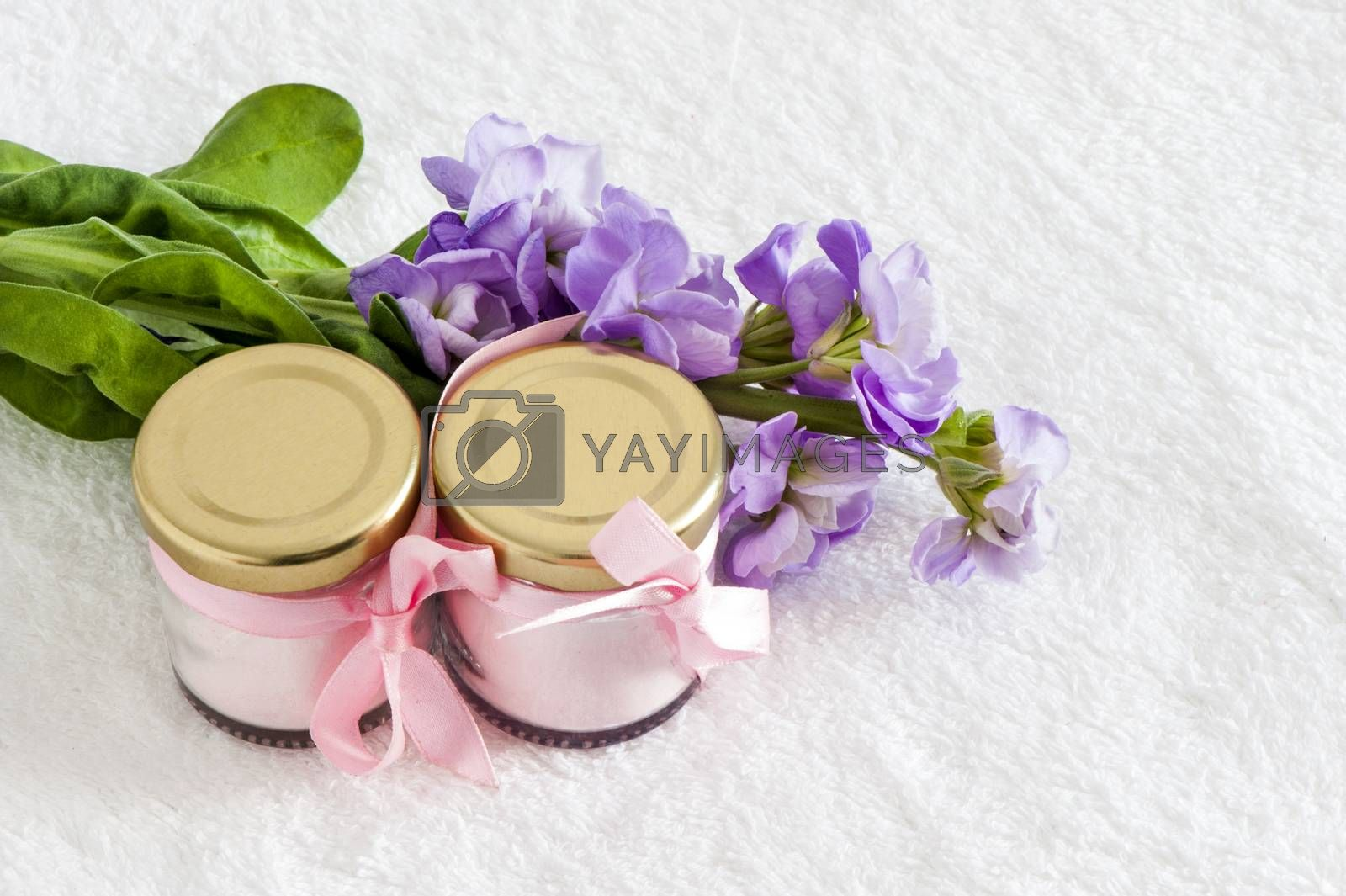 jars of natural powder pink and purple flowers