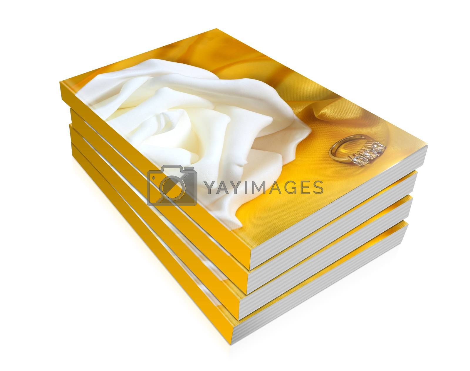 books of wedding rings on  a yellow fabric background