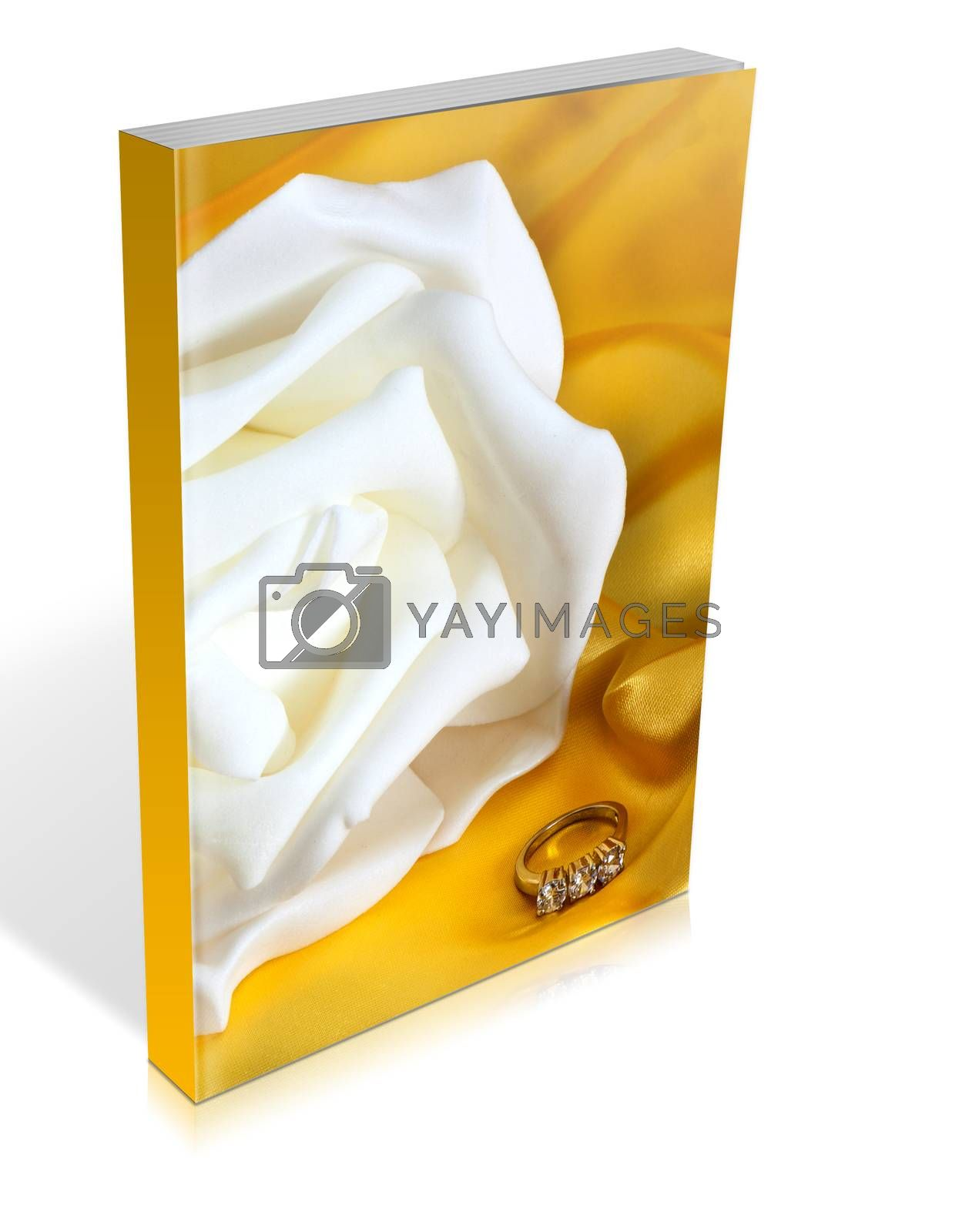 book of  wedding rings on  a yellow fabric background