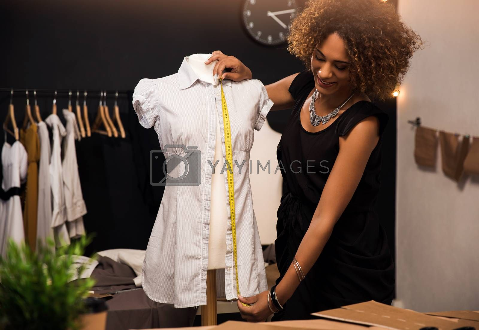 Young fashion designer working on her atelier