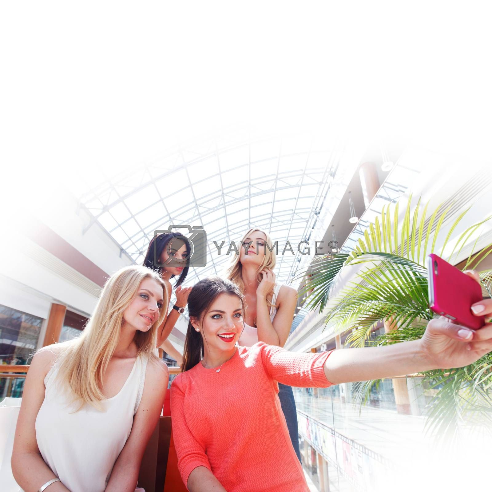 Friends taking selfie in shopping mall by ALotOfPeople
