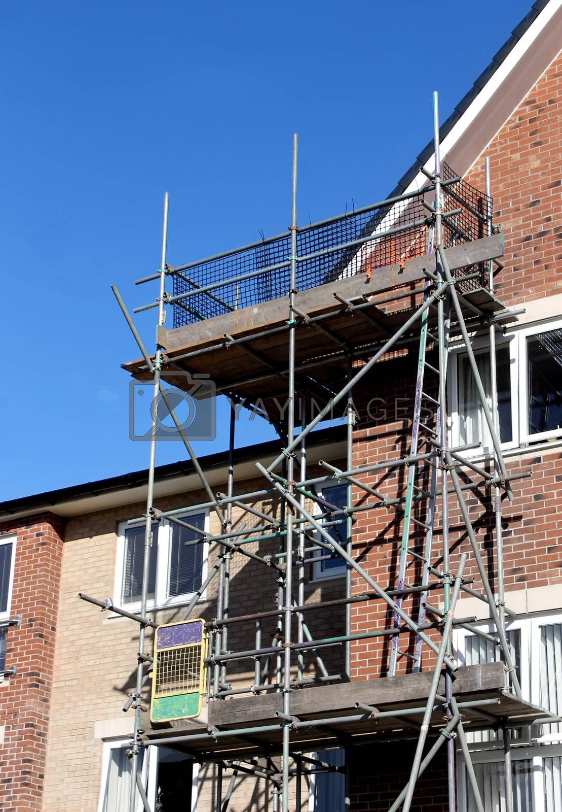 Royalty free image of Scaffolding on exterior of modern building by speedfighter