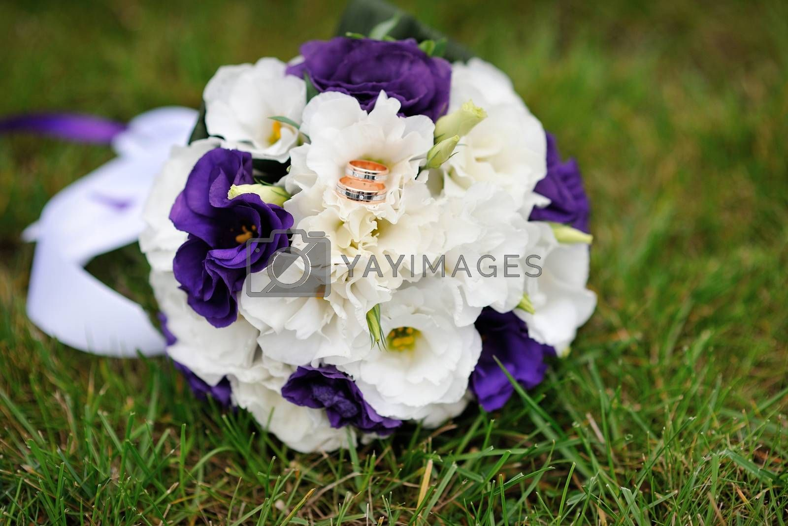 beautiful bridal bouquet lying on the grass.