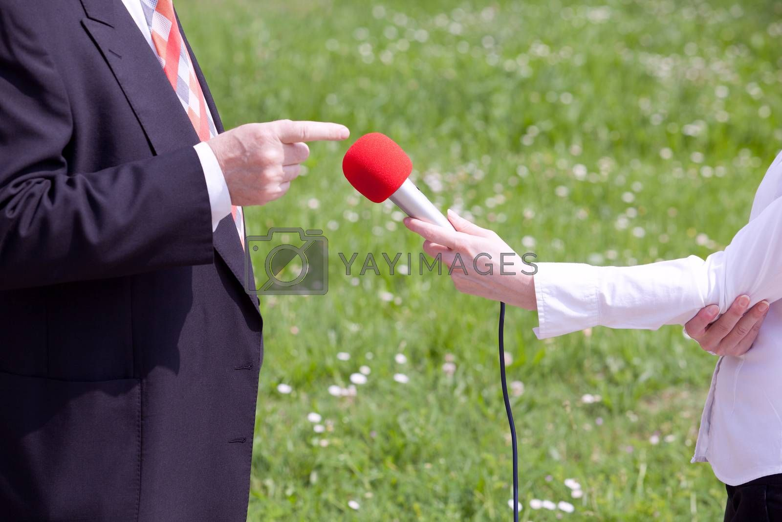 Female reporter making interview with businessperson or politician