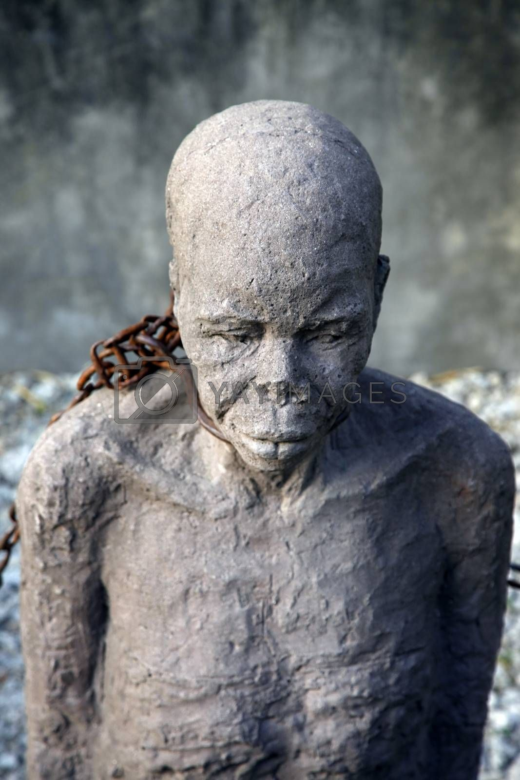 A statue in Stone Town. Zanzibar dipicting and mourning the African slave trade