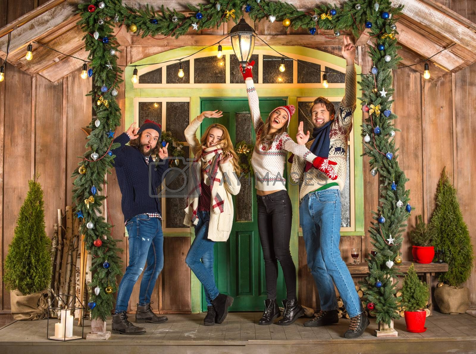 Group of happy young people having fun at christmastime