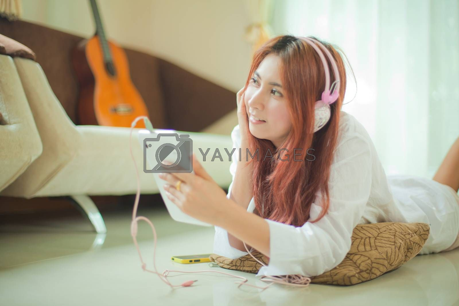 Young asian beautiful woman with smart phone and listening to music