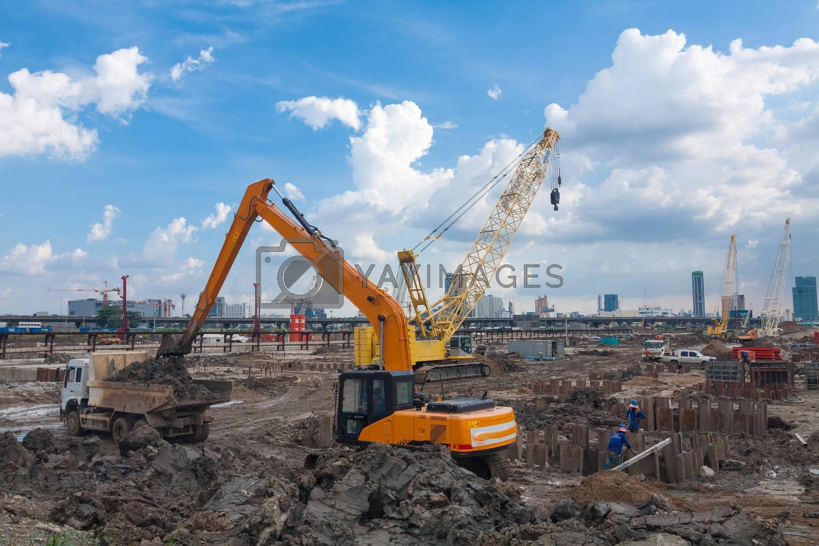The construction site. Construction of the new building. Construction cranes.