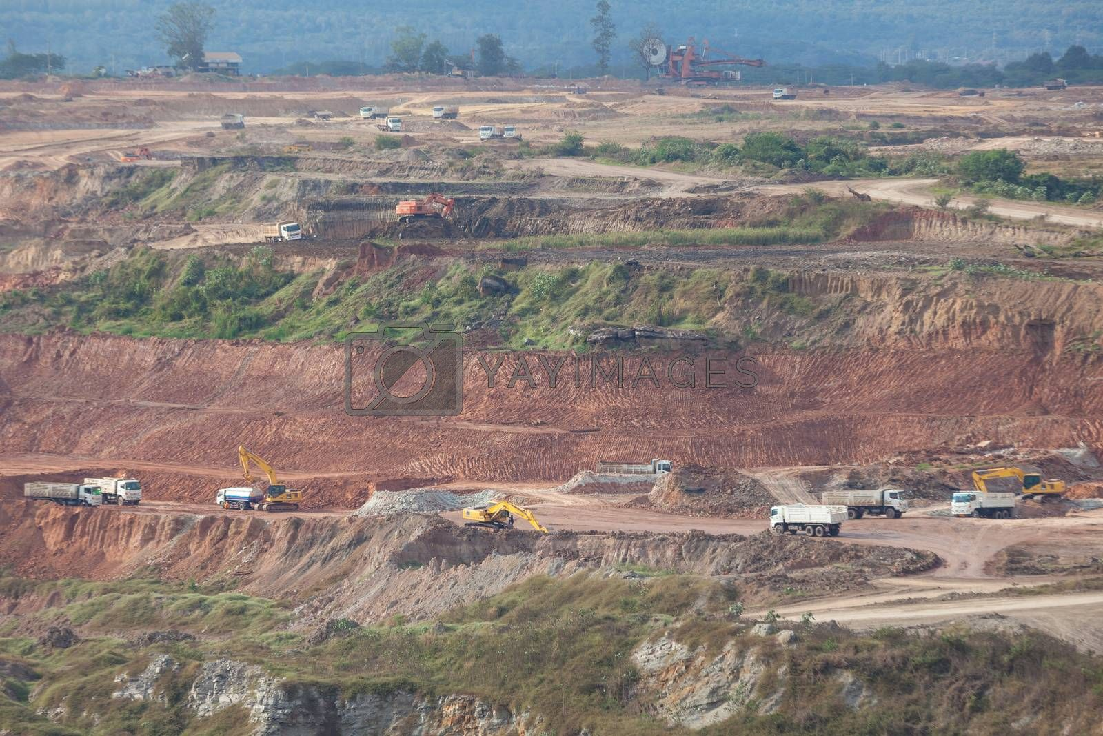 Loading of iron ore on very big dump body truck in lignite mine