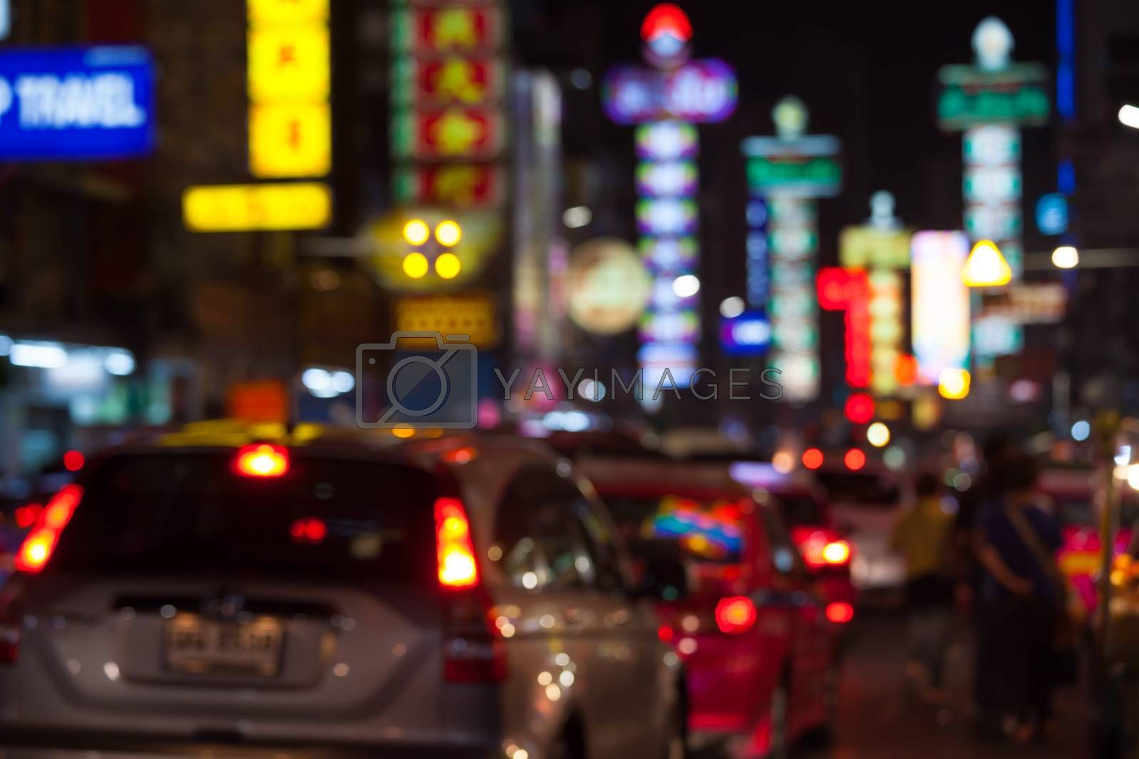 Blurred unfocused city view at night in Thailand