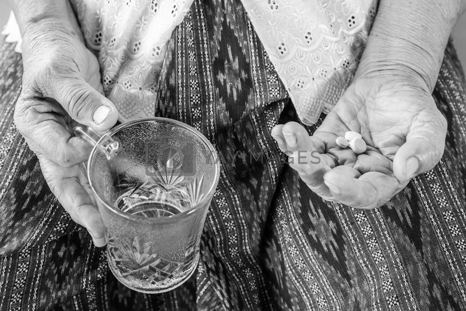 Black and white image of Senior asian woman  with medicine