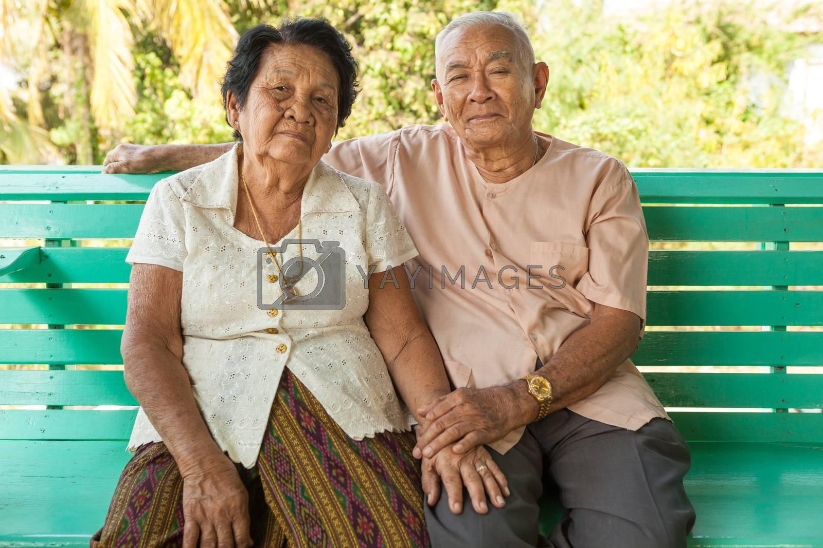 Happy Asian Senior couple sitting indoor