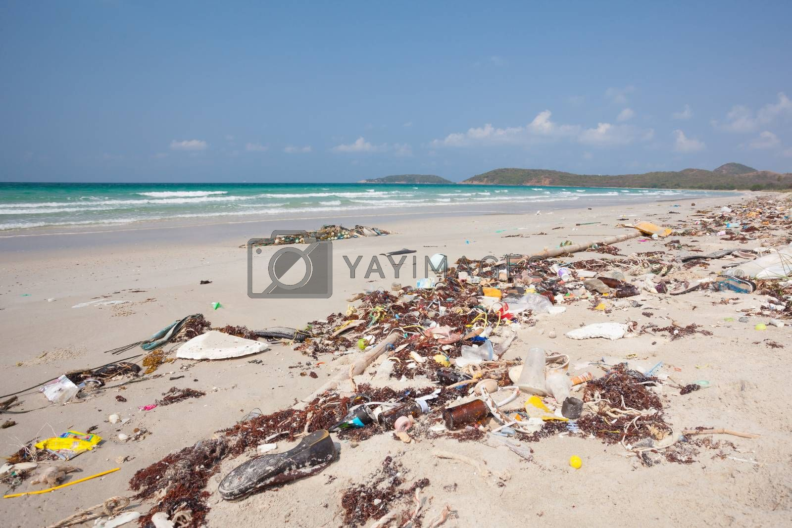 Lot of rubbish washed up on the shore on the beach