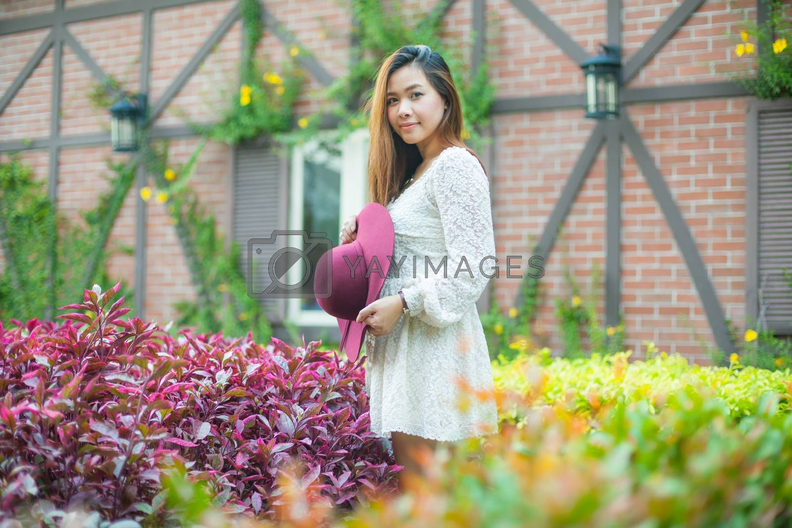 Beautiful young asian woman enjoying the freshness of a lone