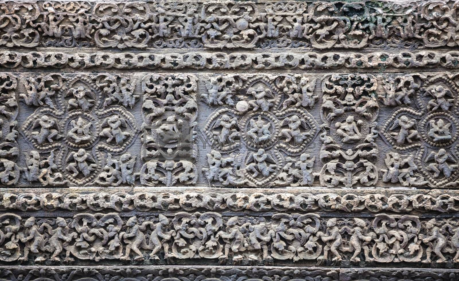 Old stone carvings on the wall temple in Myanmar