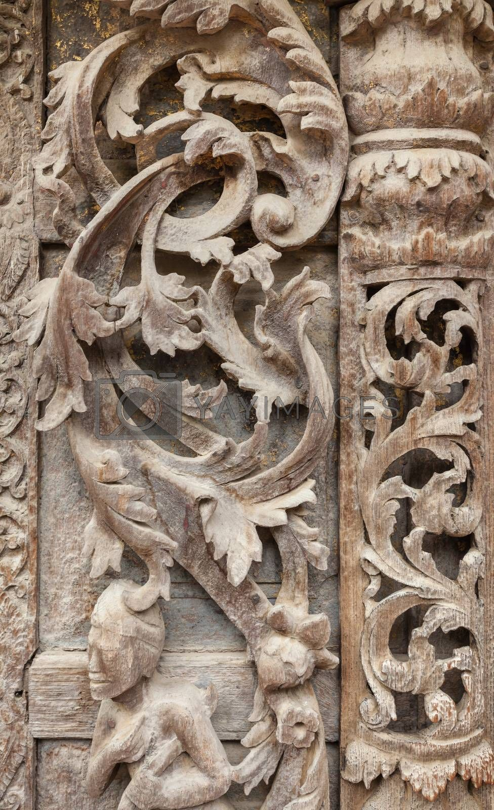Old wood carvings on the wall temple in Myanmar