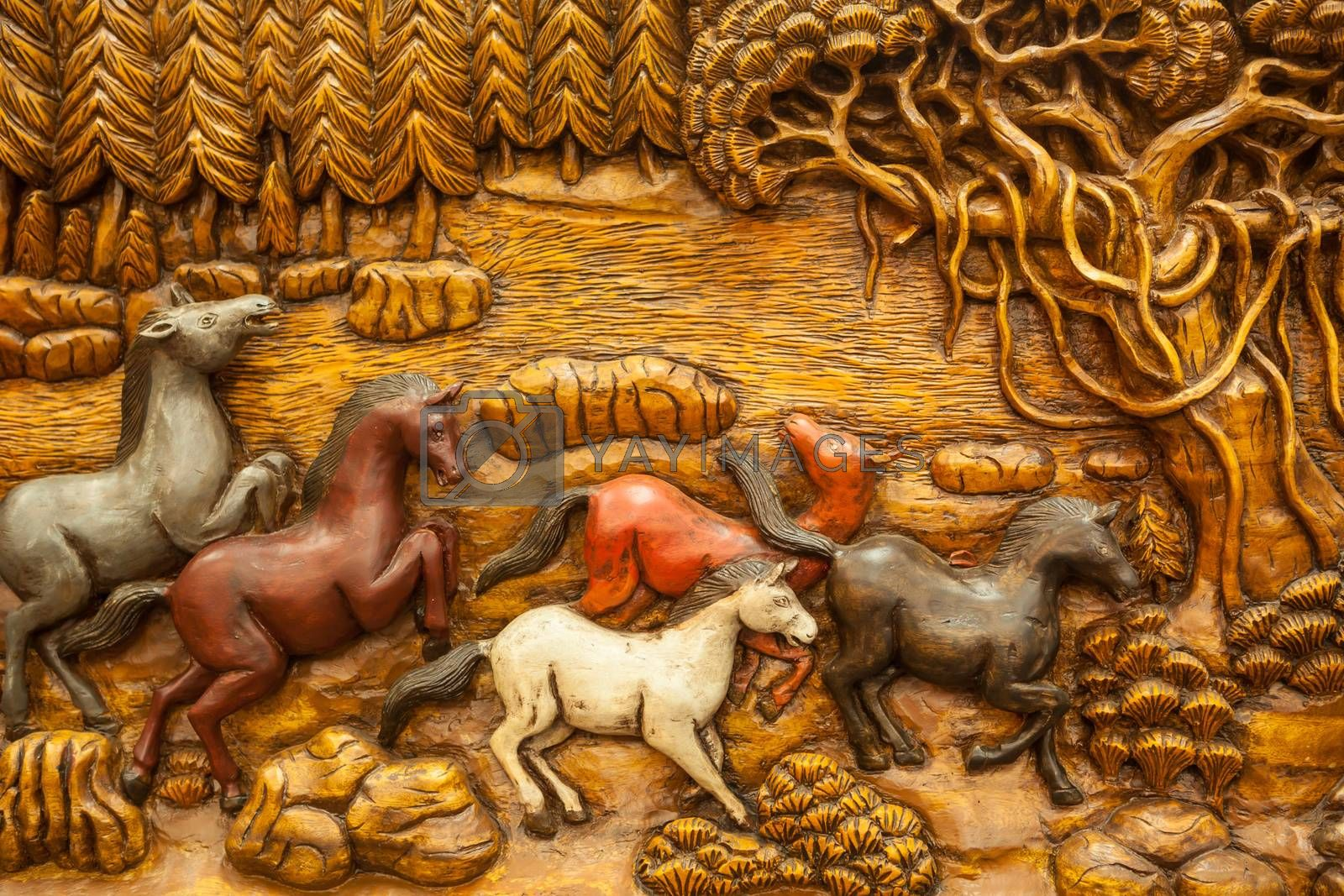 Carved Thai horse on the wood