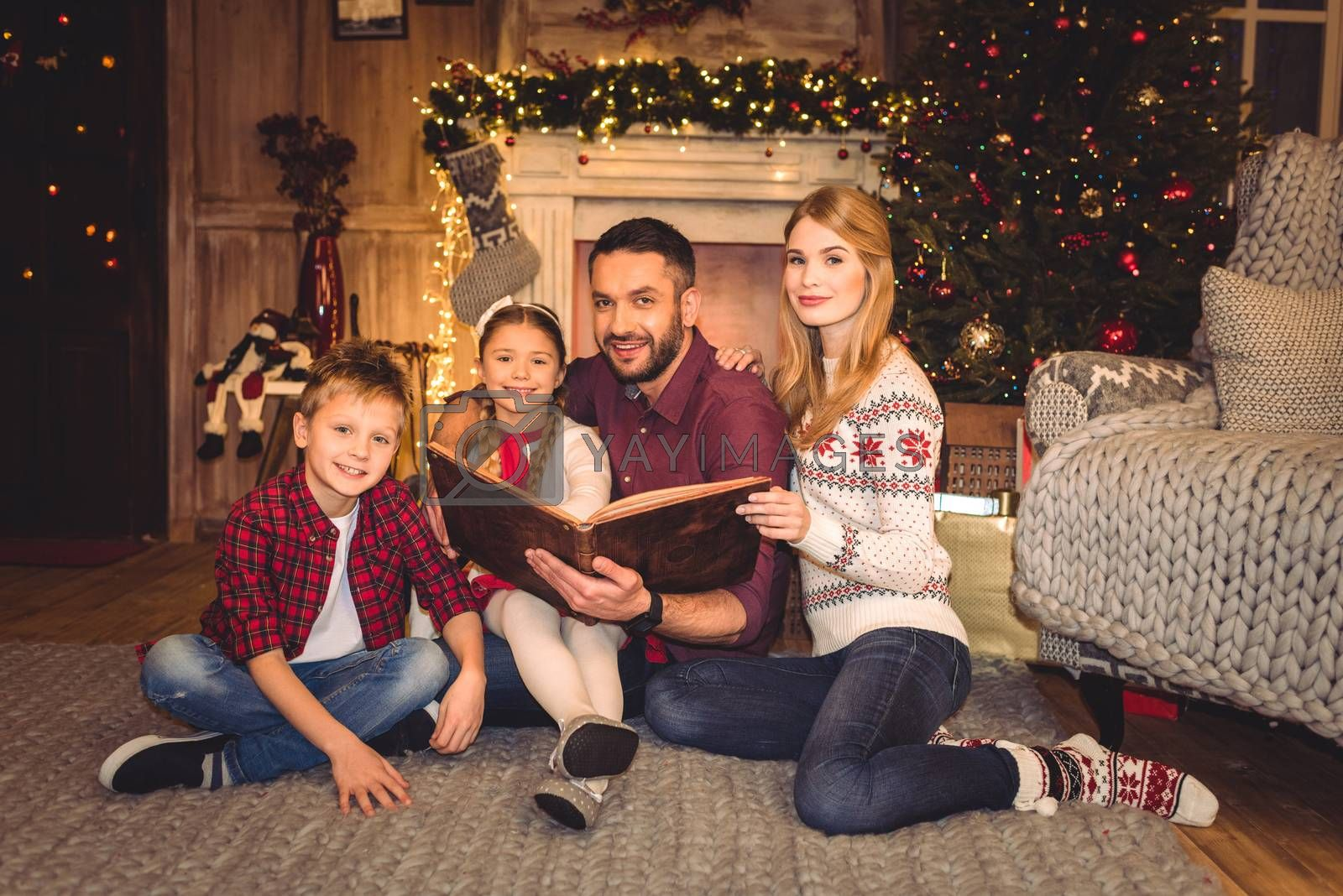 Happy family with book