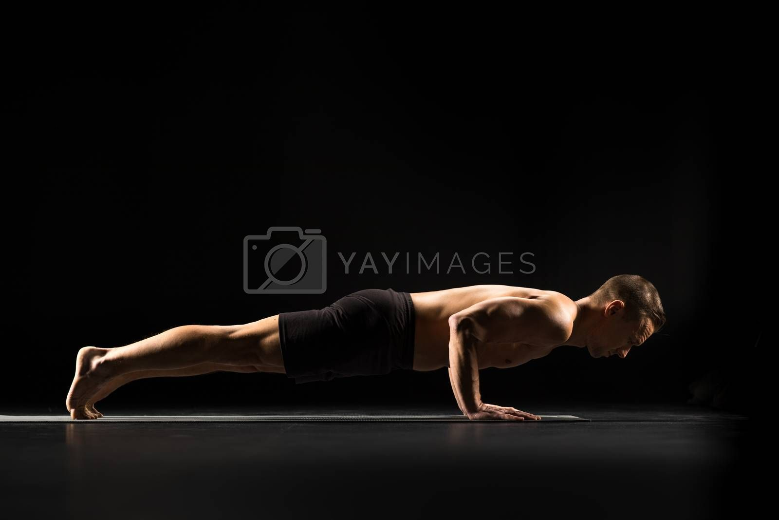 Man performing Chaturanga Dandasana or Four Limbed Staff Pose