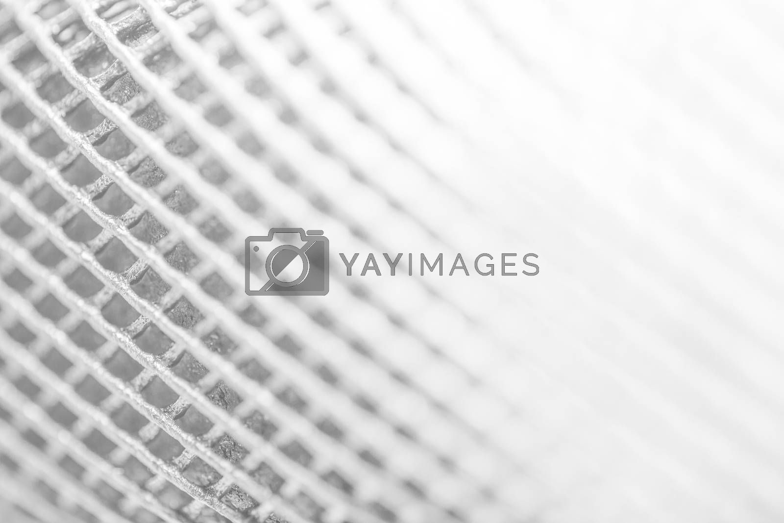 Abstract white background of grunged grid metal