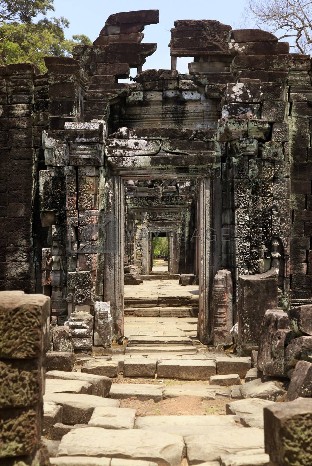 Long corridor of pillars in temple ruins. Angkor wat