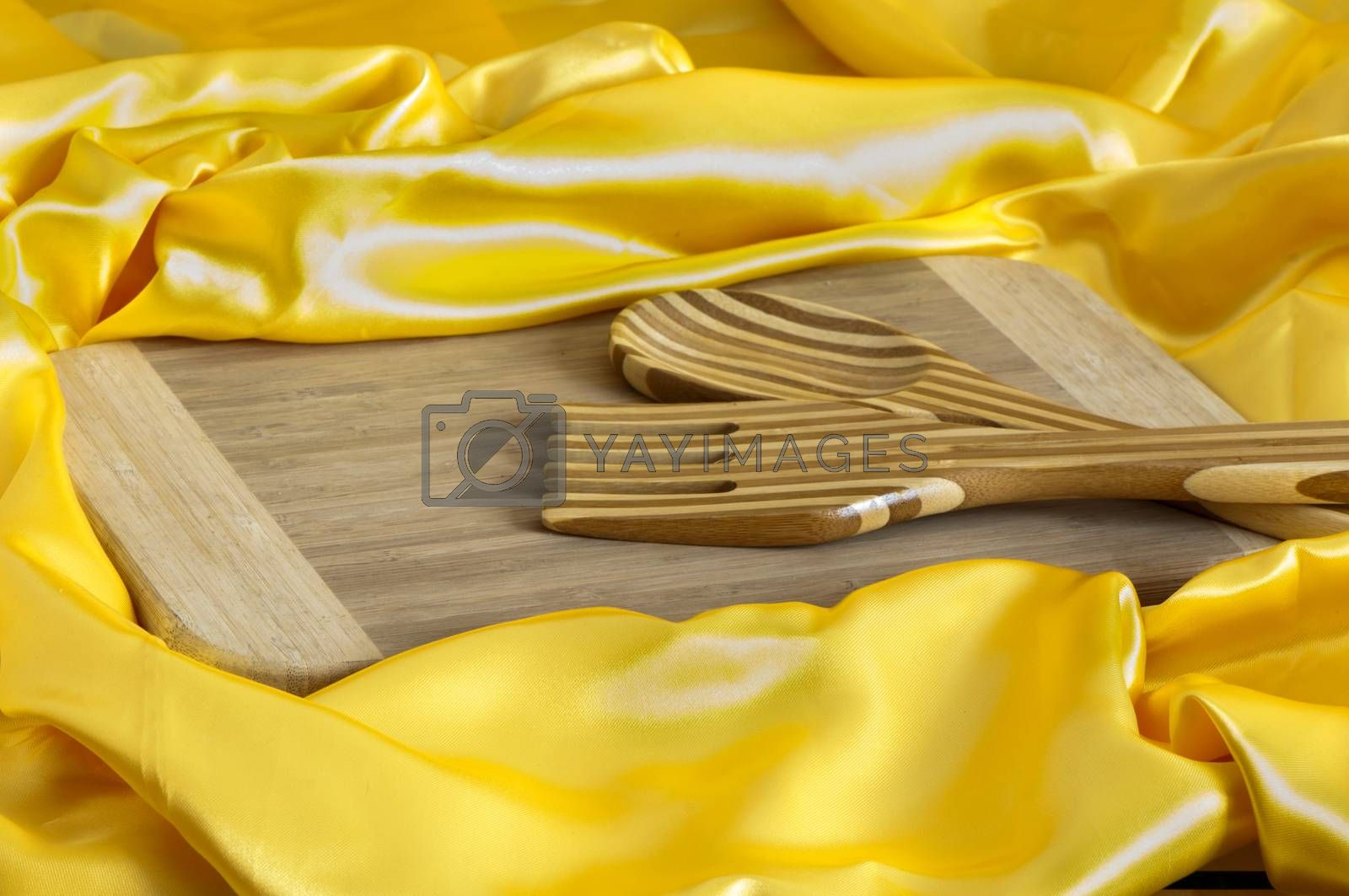 a cutlery and a bamboo cutting board