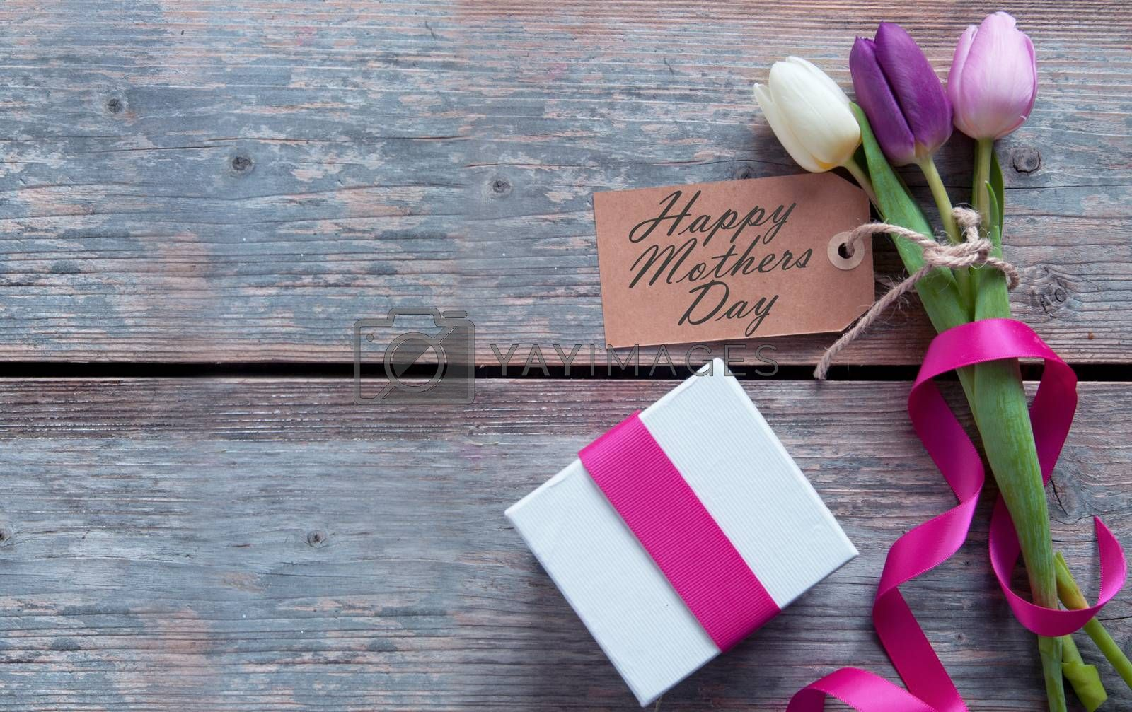 Mothers day gift flowers with blank label and decorative ribbon
